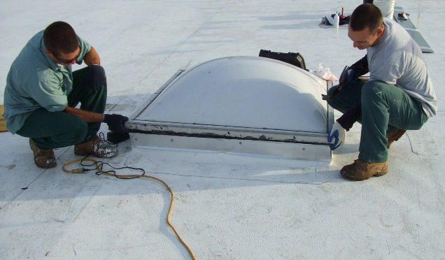 GSM workers reinstalling skylight.