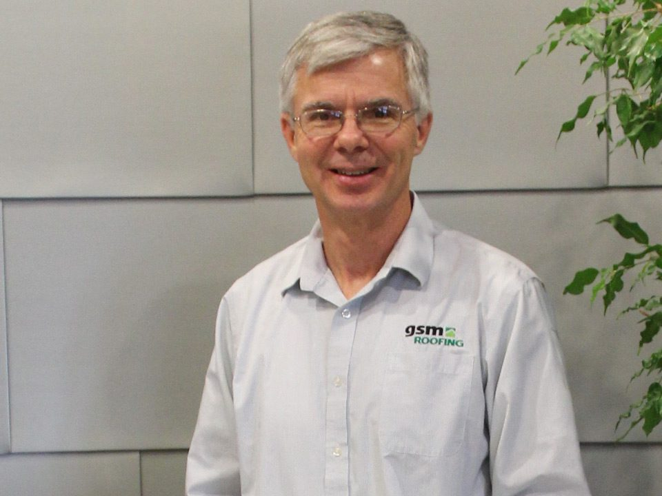 Fred Kohler standing in GSM Roofing offices